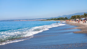 People on pebble beach San Marco in Sicily Royalty Free Stock Image