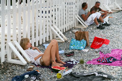 People on pebbly beach in Nice, France. NICE, FRANCE - JULY 6: local people on municipal pebbly beach in Nice, France on July 6, 2008 in Nice, France Royalty Free Stock Photos