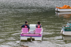People in the  pedal boats. Man and woman  on the pedal boats on the lake in Roznow , Poland. Europe Stock Photo