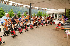 People pedaling during a spinning class Stock Images