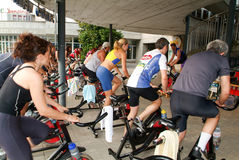 People pedaling during a spinning class Stock Photo