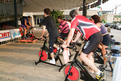 People pedaling during a spinning class Royalty Free Stock Photo
