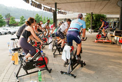 People pedaling during a spinning class Stock Image