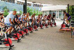 People pedaling during a spinning class Stock Photos