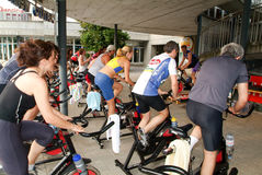 People pedaling during a spinning class Royalty Free Stock Photos