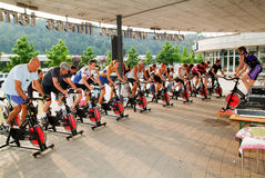 People pedaling during a spinning class Stock Photography