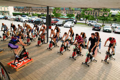 People pedaling during a spinning class Royalty Free Stock Images