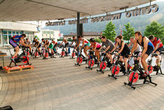 People pedaling during a spinning class Royalty Free Stock Image