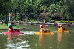 People pedalling boats on a lake in Dusit Zoo, Bangkok, Thailand stock photo