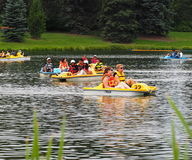 People In Peddle Boats On Small Lake Royalty Free Stock Images