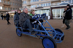 People in a peddle cart, Ostend, Belgium Royalty Free Stock Photo