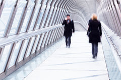 People on a pedestrian bridge Royalty Free Stock Images