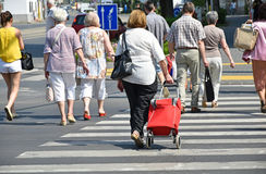 People at the pedestrian crossing in the city Stock Photos