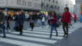 People on pedestrian crossing goes through transition. Unrecognizable people go through the pedestrian crossing, blurred view stock video footage