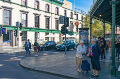 People on pedestrian crossing on intersection of Elizabeth and T Stock Photos
