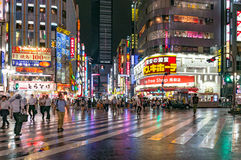 People at pedestrian crossing in Kabukicho Ichibangai. Tokyo, Japan - August 29, 2016: People at pedestrian crossing in Kabukicho Ichibangai. Text in Japanese stock image