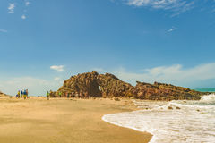 People at pedra furada Jericoacoara Brazil. JERICOACOARA, BRAZIL, DECEMBER - 2015 - Front view of pedra furada, a famous geological rock located in the beach at Royalty Free Stock Photography