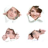 People peeping through hole in paper Stock Images