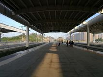 People pending in railway station platform  for the CRH arriving Stock Image