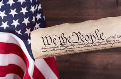 We The People. Preamble to the United States constitution, with the American flag in background Royalty Free Stock Images