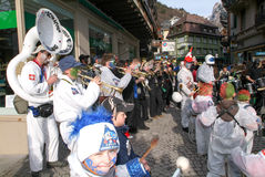 People performing Gugge Music at the carnival of Engelberg Stock Photos