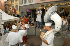 People performing Gugge Music at the carnival of Lugano Royalty Free Stock Photos