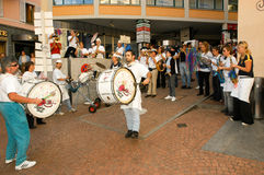 People performing Gugge Music at the carnival of Lugano Stock Photo