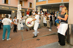 People performing Gugge Music at the carnival of Lugano Royalty Free Stock Photography