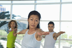People Performing Stretching Exercise Stock Image