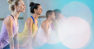 People performing yoga at gym royalty free stock image