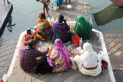 People performs morning pooja on sacred river Narmada. Maheshwar, India - 3 February 2015: People performs morning pooja on sacred river Narmada ghats in Royalty Free Stock Images