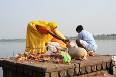 People performs pooja on sacred river Narmada in Maheshwar. Maheshwar, India - 3 February 2015: People performs morning pooja on sacred river Narmada ghats in Stock Photos