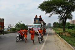 People perfroming Kanvar Yatra or Kavad Yatra (Hindi Words), it is annual pilgrimage of devotees of  Shiva Royalty Free Stock Photo