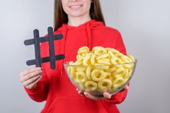 People person share free time concept. Cropped closeup photo of positive cheerful satisfied cool good pretty lovely girl holding. Bowl with round crisps gray royalty free stock photography