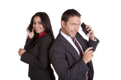People on phone back to back Royalty Free Stock Photography