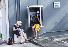 People phoning in the street Stock Photos