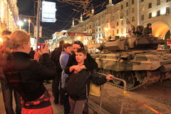 People are photographed against tanks. In streets of Moscow Stock Images