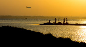 People photography planes by the sea at sunset royalty free stock photos