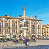 People in Piazza del Duomo in Catania. Catania, Italy - March 16, 2019: People in Piazza del Duomo near Fontana dell Elefante in Catania stock photography