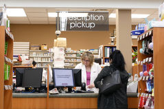 People picking up her prescription medicine stock photo