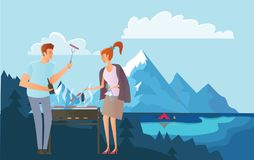 People on picnic or Bbq party in the mountains. Man and woman cooking steaks and sausages on grill. Mountain landscape Stock Images