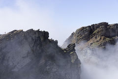 People on the pico arieiro on madeira island in the clouds Royalty Free Stock Photography