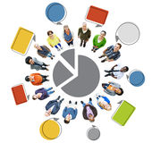People with Pie Chart and Empty Speech Bubbles Royalty Free Stock Image