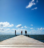 People on a pier. People standing together on a pier Royalty Free Stock Photos