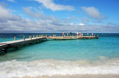 People On A Pier. Tourists are walking on a pier on Roatan island, Honduras Royalty Free Stock Photography