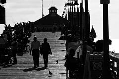 People on the Pier in California. Enjoy the people on the  pier in San Diego, California walking and relaxing Royalty Free Stock Image