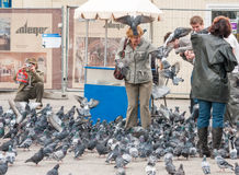 People and pigeons on  Main Market Square, Krakow, Poland Royalty Free Stock Photo