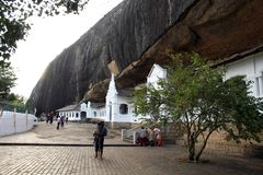 People, pilgrims, and tourists around the Dambulla Cave Temple royalty free stock photo