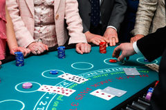 People placing bets on Black Jack card game Stock Image