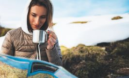 People planning trip in snow mountain, girl hold in hands cup of drinks, relax tourist look on map, hipster enjoy on background. Winter nature, journey royalty free stock photo